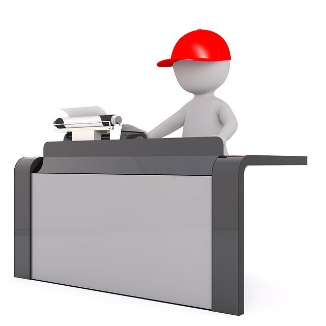 pracovník tisknoucí na tiskárně